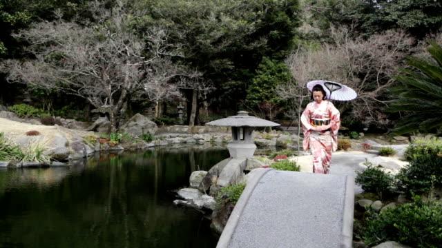 HD: Japanese woman walking in garden (video) video
