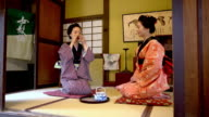 DS Japanese women in traditional kimonos drinking tea video