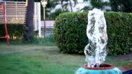 jar fountain in the garden on Slow motion footage video