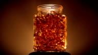 Jar of Gold Coloured Vitamins Lid Off video