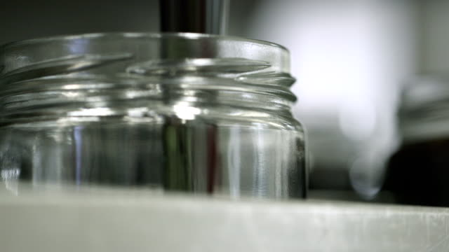 Jars being filled with syrup video