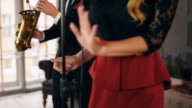 Jazz vocalist perform on stage. Dancing, Click fingers, Duet. Saxophonist plays video
