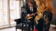 Jazz vocalist perform on stage with saxophonist. Retro style. Bright make up video