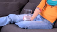 jeans woman with effervescent medicine video