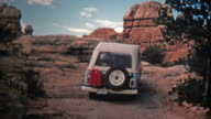 1971: Jeep driver bouldering up a steep incline offroad trail. video