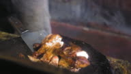 Jerk chicken preparing on barbecue grill in commercial kitchen, Jamaica video