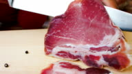 Jerked meat sliced with a knife video