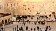 Jerusalem, Western Wall, people in the area, a lot of people, people pray at the stone wall, wailing wall, Israel flag, religion, top shooting, view from above video