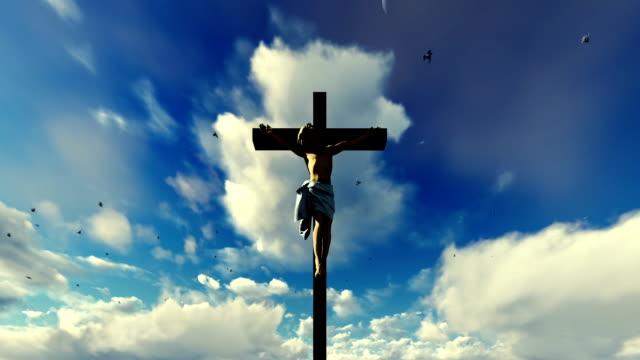 Jesus cross against heavenly blue sky with pigeons flying video