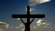 Jesus on Cross, close up, timelapse sunset, godrays video
