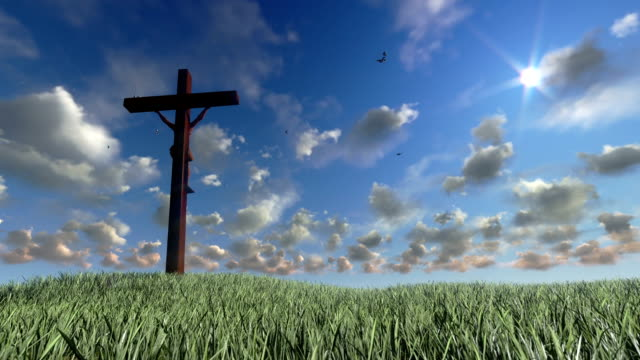 Jesus on Cross, meadow and timelapse clouds video