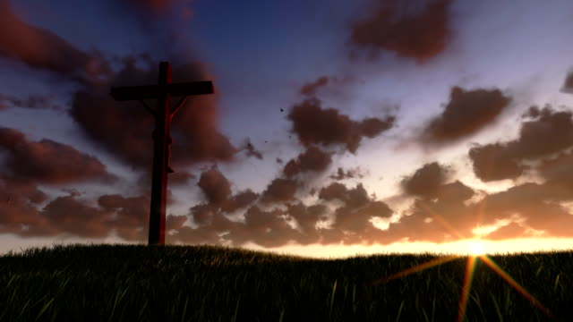 Jesus on Cross, meadow and timelapse sunrise video