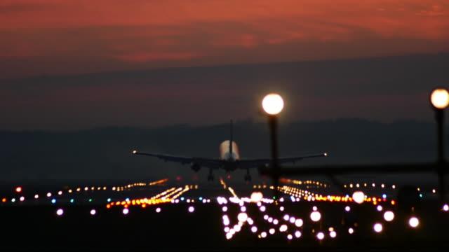 Jet airplane landing at sunset. video