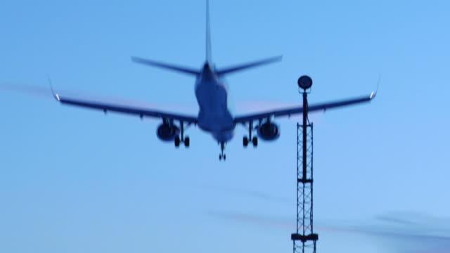 jet landing at dusk (HD video) video