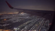 Jet plane landing in Los Angeles LAX airport. Window view with wing video