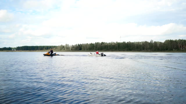 Jet Ski with boat on rope tow video