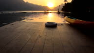 Jetty at sunset with Canoe and Lifebuoy video