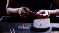 Jeweler produces the silver chain. video