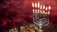 Jewish holiday hannukah symbols - menorah and wooden dreidels video