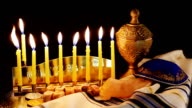 jewish holiday Hanukkah with menorah over wooden table video
