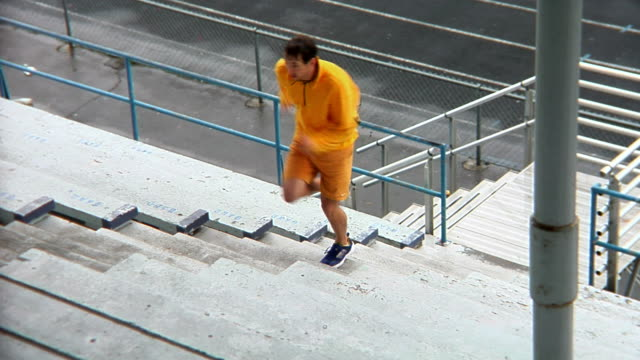 Jogger Stairs Track Left Medium Wide Shot HD video
