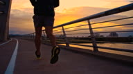 TS Jogging Across A Bridge Over The River video