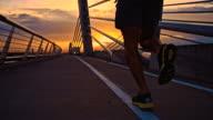 SLO MO Jogging Across A Bridge video