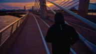 TS Jogging Across The Bridge At Dusk video