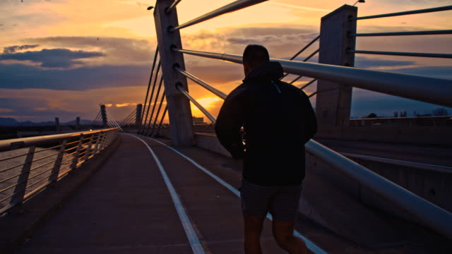 TS Jogging Across The Bridge At Sunset video