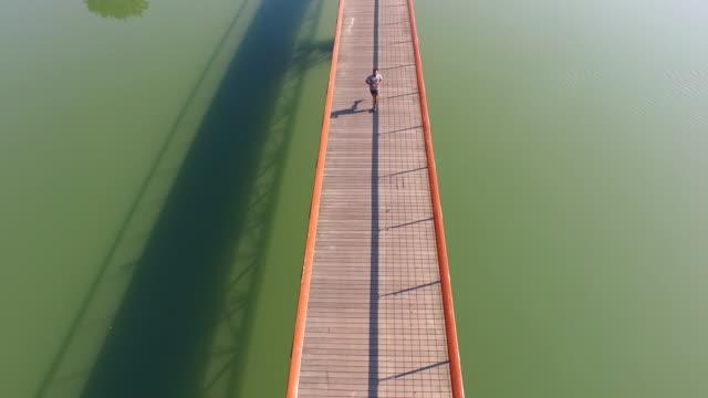 AERIAL Jogging across the bridge video