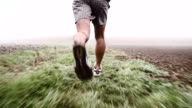 SLO MO Jogging Across The Foggy Field video