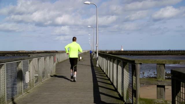 Jogging along a Pier video
