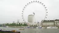 WS PAN Jogging Along Thames, Millennium Wheel video
