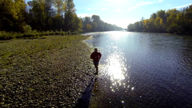 HD: Jogging Along The River At Sunset video