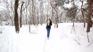 Jogging female in winter forest video