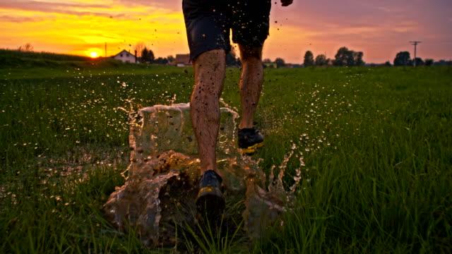 SLO MO Jogging Through Puddles At Sunset video