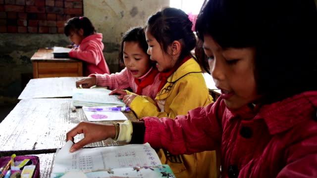 Jolly Chinese school children reading video