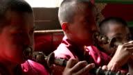 Jonangpa school monk students playing woodwind instruments video