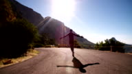 Joyful athlete running on a road in the morning video