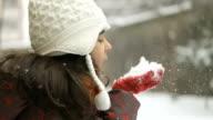 Joyful child having fun with snow in winter day video