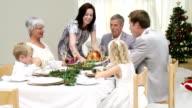 Joyful extented family having Christmas dinner video