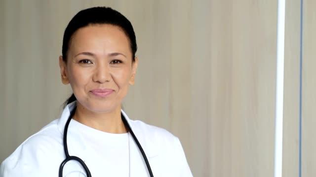 Joyful female doctor welcoming her patients video