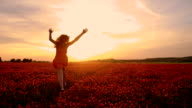 SLO MO Joyful girl running in field of crimson clover video