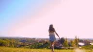 SLO MO Joyful girl running with dandelion seeds video