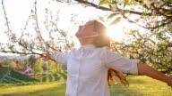 SLO MO Joyful girl under the blooming tree video
