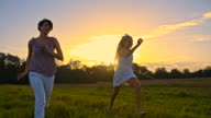 TS Joyful Mother And Daughter Running At Sunset video