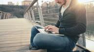 WS Joyful Student Using Laptop On Bridge video