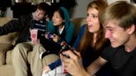 Joyful Teens Play with Video Game video