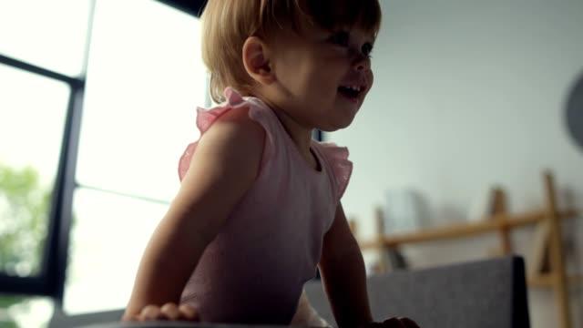 Joyful toddler having playing at home video
