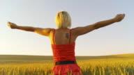HD CRANE: Joyful Woman In The Field video